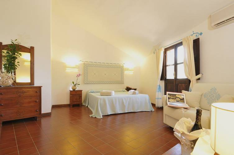 Superior double room with partial sea view sigillum cala moresca at arbatax park arbatax - sardinia